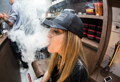 Young Woman Producing Clouds of Vape