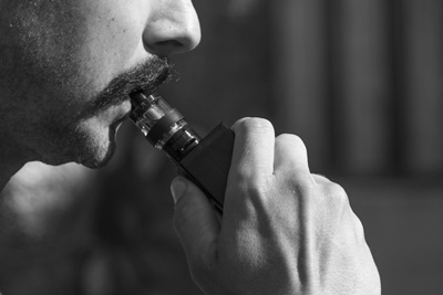 Man vaping wondering why his vape is harsh