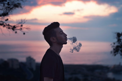 Man blowing clouds