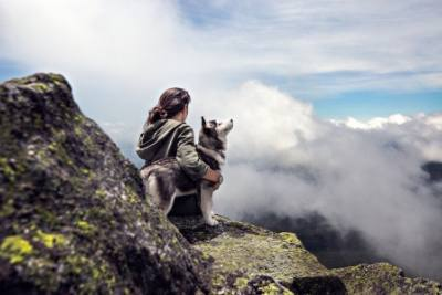 Woman on mountain with dog