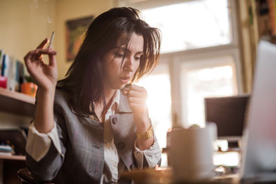 Woman-Coughing-from-cigarettes-in-a-smoking-relapse
