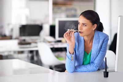 Woman-having-a-quick-vape-between-meetings-at-work