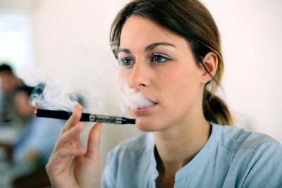Woman vaping with an electronic cigarette