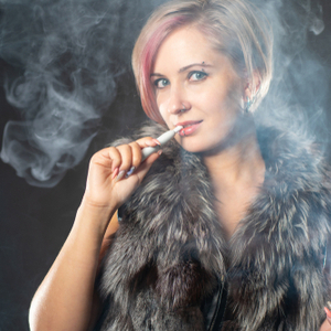 woman vapourizing heated tobacco